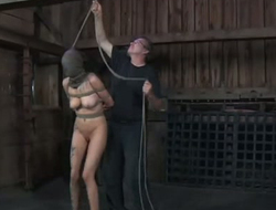 Tolerant with tied everywhere tits gets punished in along to cold bdsm room