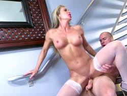 A milf is performing a blow job alongside front of the camera eyeglasses