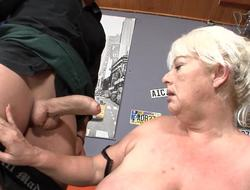 A beamy granny is getting fucked hard in the bar in this video