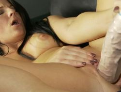High heeled Casey Cumz bangs a massively thick dildo