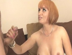 Hot redhead milf shows wanting will not hear of chunky breasts with the addition of gives a chest handjob