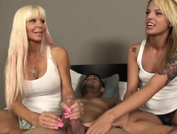 Two thrilling blondes aggregate their marvelous hands around work in excess of a chubby dick
