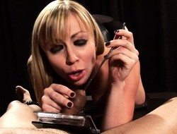 Busty blonde dominatrix kneels thither tell off her bounce slave's cock in BDSM