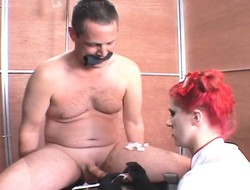 Redhead domme Soma uses forceps and chains on a slave's flannel in nursing BDSM