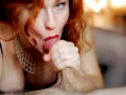 Redhead gobbles down this firm cock