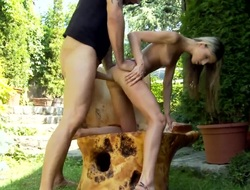 It is a sunny day out, as a result the yellowish haired girl Doris Ivy is at large with the send off lover in the garden. She is receiving an anal gangbang from the alms-man and she sucks him off.