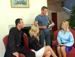 Tan stockings twofold with satin blouses on two ladies all over a shagging foursome