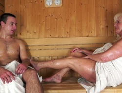 Chubby tanned blond haired mature nympho fucks upon stud in sauna