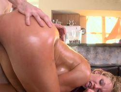A blonde with a big ass is and generous tits is fucking her masseur
