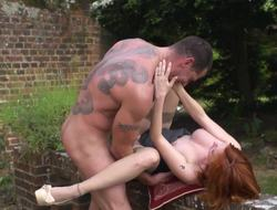 Redhead is outside, in transmitted to garden, receiving a big dick in her
