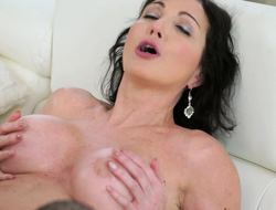 Dark-haired MILF made herself pretty for lovemaking with admirer