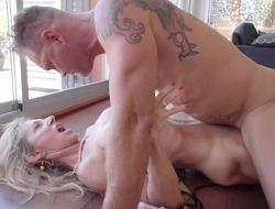 A blonde full-grown babe in the matter of a sexy cunt is handling a fat cock