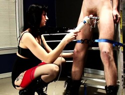 Dark-haired vixen uses a vibrator to stimulate say no to slave's penis