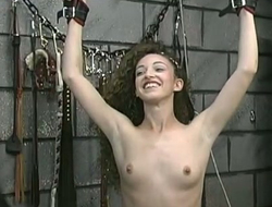 Titless red haired bit of San Quentin quail is punished give whip in chum around with annoy bdsm room