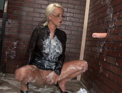 Rubber dick at a gloryhole squirts cream on this attracting cookie