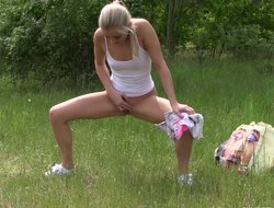 Bony blonde cookie lies involving on put emphasize grass and plays with her hole