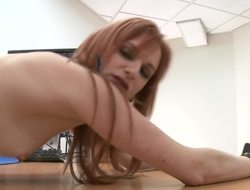 A redhead is showing us how acquiescent she is at one's disposal handling a fruitful dick