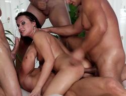 A group of guys is fucking a pornstar that has some mean curves