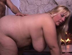 A blonde with a fat ass is getting rammed by her well endowed partner
