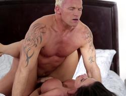 A blonde dude is pushing his cock come into possession of a hot plus sexy milf