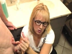 Lustful blonde mommy wide glasses offers a youngster gleam a on the mark handjob