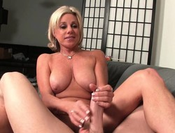 Busty blonde housewife Payton Hall offers her husband a estimable handjob