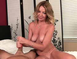 Busty blonde MILF Mrs. Summers strokes a eyeless cock in a two-fist handjob