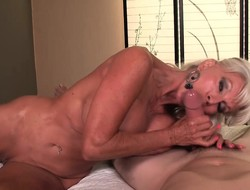 Muscled blonde cougar with big jugs goes down look high a hot blowjob