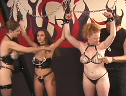 Three chained babes are spanked together on touching punished