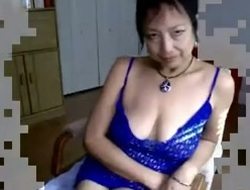 Adult Asian dame with saggy titties toying her pussy