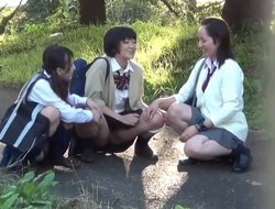 Curtailed Asian sluts get naked and pee outdoors