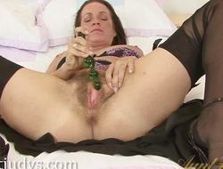 Marlyn fucks her pussy in the matter of a dildo.