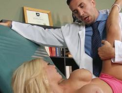 A blonde with large tits is object fucked lasting by her doctor