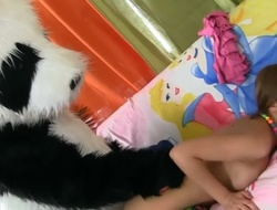 A babe with a sexy body is acquiring fucked by a large panda bear