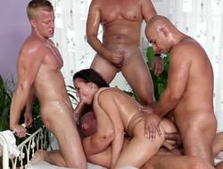 Several females have ganged up on a hot brunette in a gangbang
